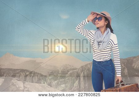 Digital composite of Composite image of woman in the mountain