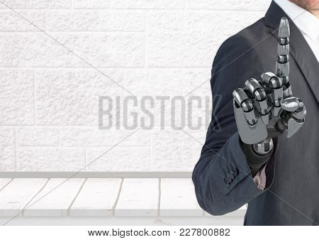 Digital composite of Android Robot Businessman hand pointing with bright background