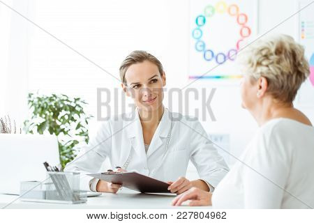 Smiling Dietician Conducting Medical History