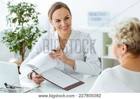 Smiling Doctor During Medical Examinations