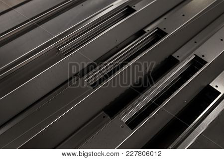 Presswork Metal Blanking Closeup. Abstract Industrial Background