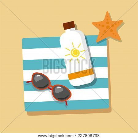 Tourism. Flip- Flops In The Sand With Towel, Sun Glasses And Cream From Tan