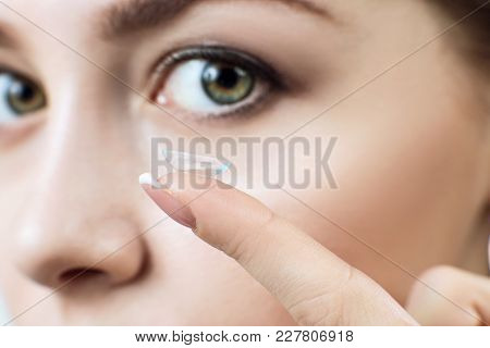 Close-up Shot Of Young Woman Wearing Contact Lens For A Better View.