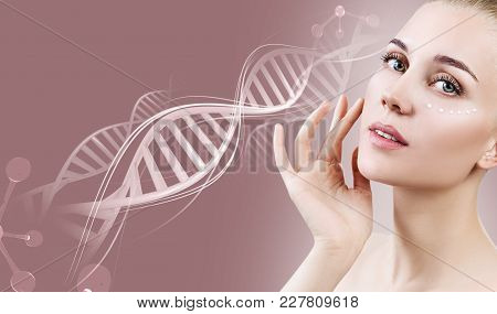 Portrait Of Sensual Woman With Cream On Face In Dna Chains Over Beige Background.