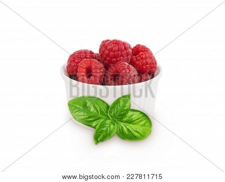 Raspberries With Basil Leaves In A Bowl Isolated On White Background. Vegetarian Or Healthy Eating.