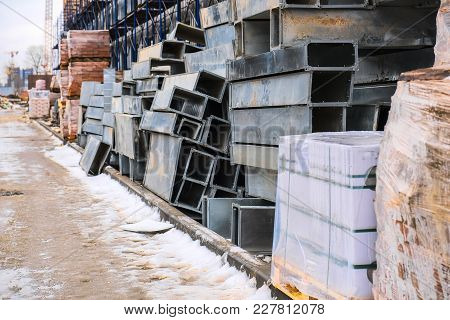 Warehouse Of Building Materials Along The House Under Construction