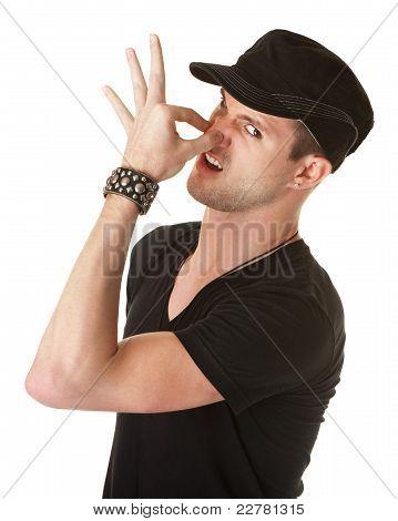 Man Pinching His Nose