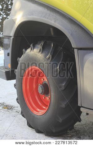 Close-up Of Big Truck Wheel, Construction And Machinery Concept