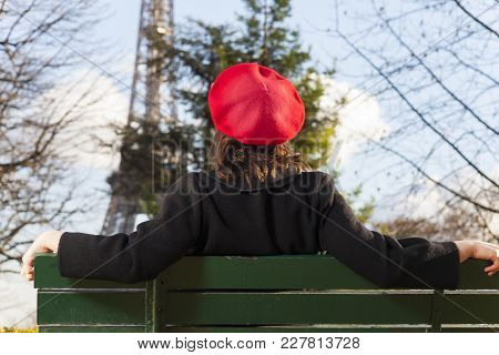 Young Woman With A Beret And The Eiffel Tower