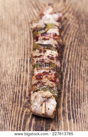 Closeup Of A Shashlik Skewer On Wood