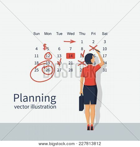 Mark Calendar. Businesswoman Makes Notes On Calendar. Planning Working Month. Schedule Record Remind