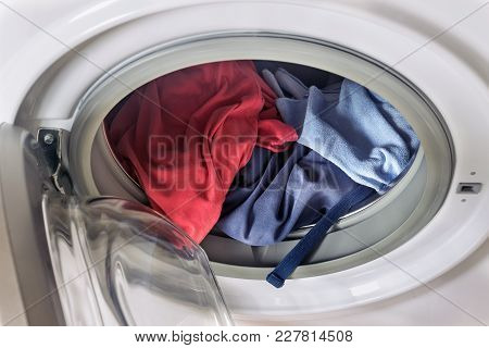 Clothing In Washing Machine.  Concept- Laundry, Housework, House Cleaning.