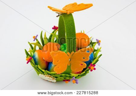 Easter Basket With Flowers And Oramge Butterflies