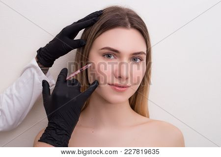 Care For Your Beauty! Young Smiling Lady Receiving Hyaluronic Acid Injection In Her Face.