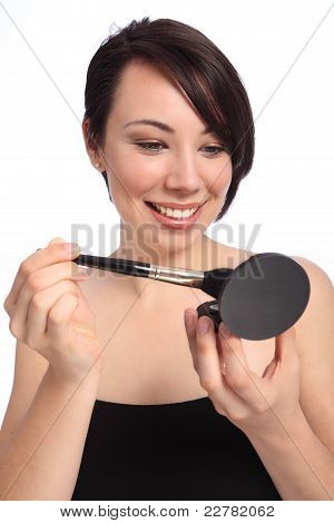 Make Up Using Cosmetic Compact And Blusher Brush