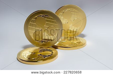 On The White Background Are Gold Coins Of A Digital Virtual Crypto  Currency - Ripple. In Addition T