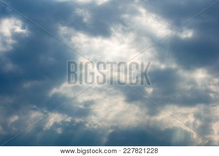 Beautiful Cloudscape With Large, Building Clouds And Sunrise