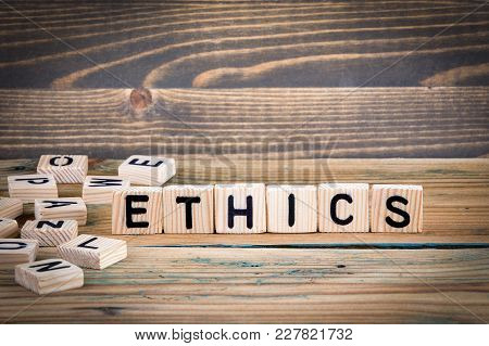 Ethics. Wooden Letters On The Office Desk, Informative And Communication Background.