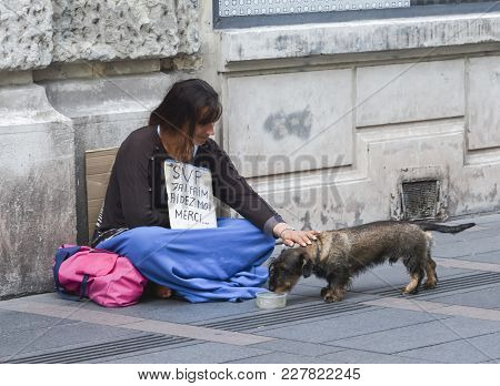 A Hungry Woman Begs Alms In The Street