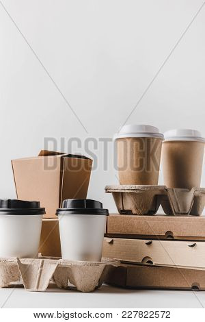 Pizza Boxes And Coffee To Go With Food Containers On Tabletop