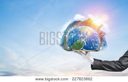Hand Of Waitress Presenting Earth Globe On Tray.