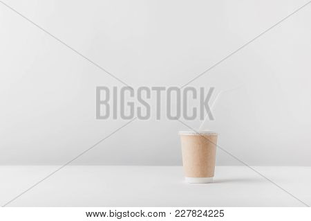 One Disposable Coffee Cup On White Tabletop
