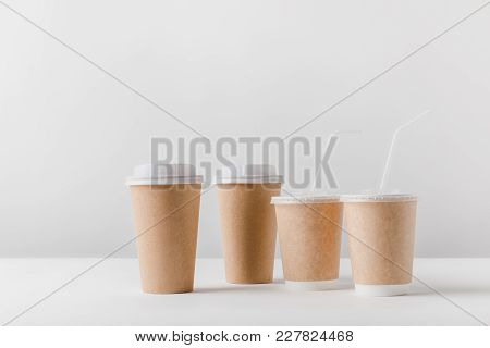 Different Coffee In Paper Cups On Tabletop