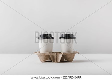 Two Coffee In Paper Cups In Cardboard Tray On Tabletop