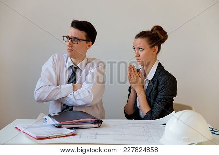 A Portrait Of Two Businesspeople Under Stress