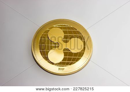 On A White Background Is Gold Coin Of A Digital Crypto  Currency - Ripple Xrp. The Front Side Of The