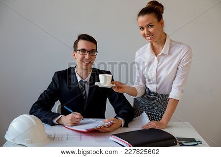 Attractive Secretary Brings Coffee To Her Boss In The Office