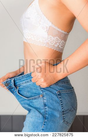 Young Woman Showing Weight Loss With Her Dieting Results., Healthcare And Dieting Concept