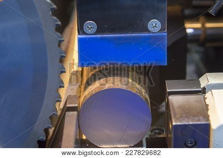 The Band Saw Machine Cutting The Metal Rod.raw Material For Manufacturing Process.