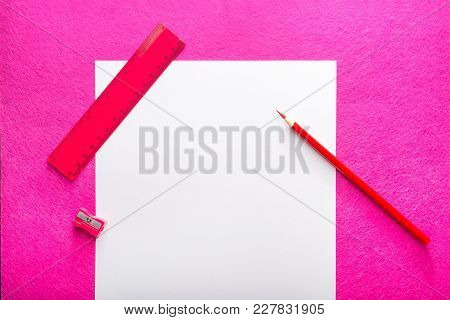 Red Pencil With Pencil Sharpener, Ruler And White Paper Sheet On Red Background. Flat Design. Statio