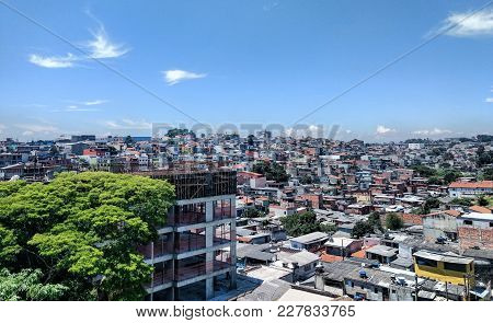 Houses In A Favela Near A Construction Building