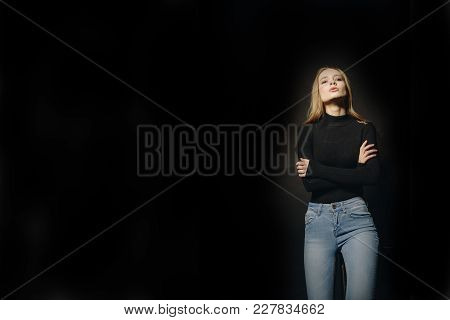 Fashion Portrait Of Stylish Woman Posing In Studio Wearing Black Sweater. Wave Hair. Concept Of Busi