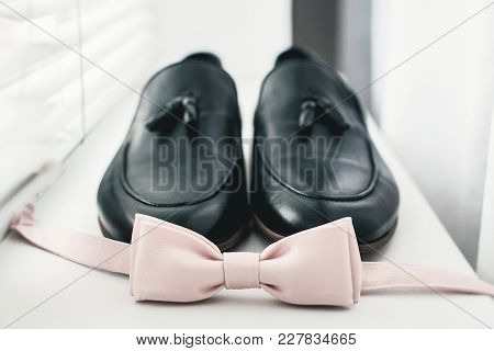Close Up Of Modern Man Accessories. Beige Bow Tie, Black Leather Shoes. Close Up Of Modern Man Acces