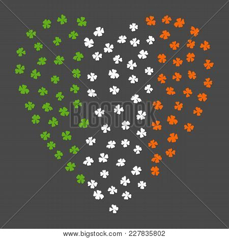 Clovers Heart For St. Patrick's Day. Irish Flag. Ireland Flag Made Of Clover Laef. Grey Background.