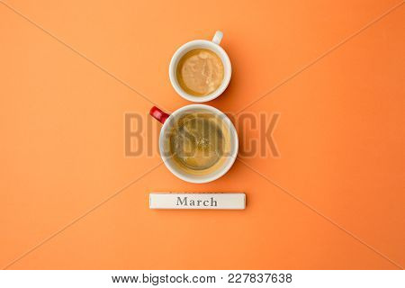 View From Above With Two Cups Of Coffee With Copy Space. Background For Woman Day, 8 March. Orange T