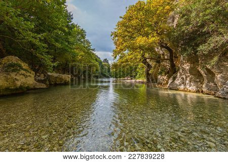 Wild Acheron River In Greece With Clouds And Natural Vegetation