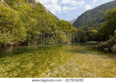 Acheron River In Greece With Blue Sky And Natural Green Vegetation