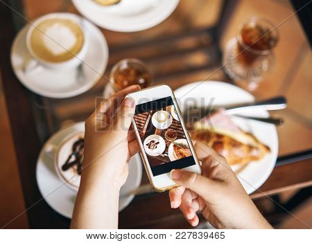 A Woman Is Holding A Phone. Breakfast For Two: A Croissant With Ham, Coffee, A Refreshing Drink, Swe