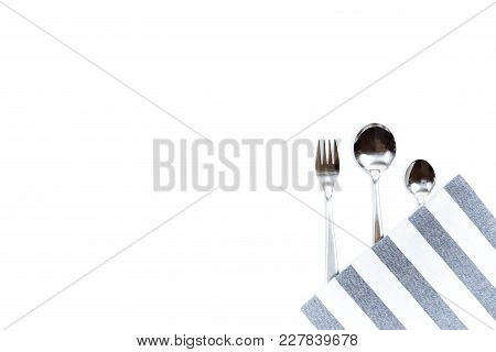 A Set Of Cutlery, Forks And Spoons. Copy Space