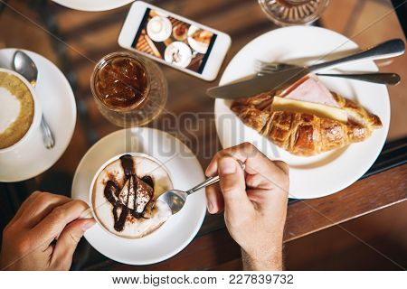Male Hands Holding A Cup Of Coffee. Morning Breakfast For Two: Croissant With Ham, Coffee, Refreshin
