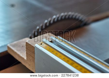 Measuring Scale With A Stopper On The Panel Squaring Saw