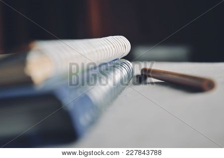 Depth of field of Loop binding book and pencil on the bed with light from the window on the morning concept of education and business poster