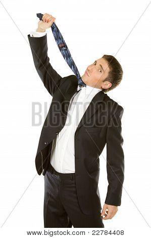 Business Frustration- Mature Man Pulling Necktie To Choke Himse