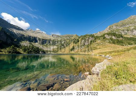 Campo Lake (lago Di Campo 1944 M.) In The National Park Of Adamello Brenta.in The Background The Pea