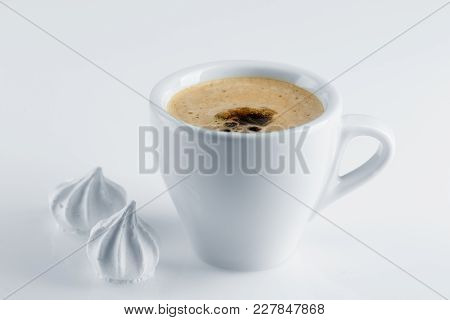 Coffee In A White Porcelain Cup, Black Coffee And White Meringues On A White Surface, An Invigoratin