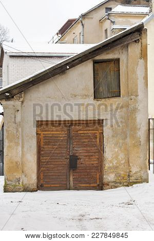Wooden Plank Door Of Old House In Winter